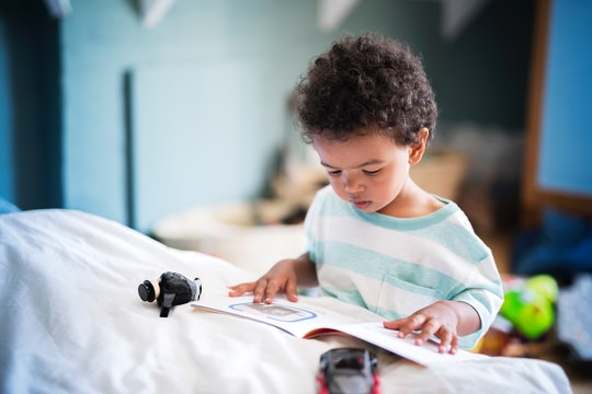 kid reading children's book about the wonder of being at home