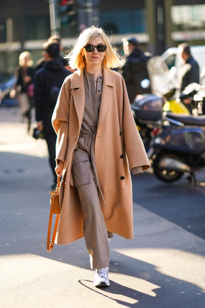 Woman wearing a trench coat.