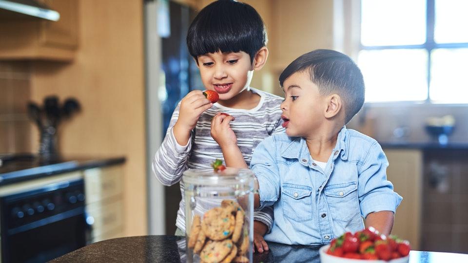 kids eating strawberries and cookies