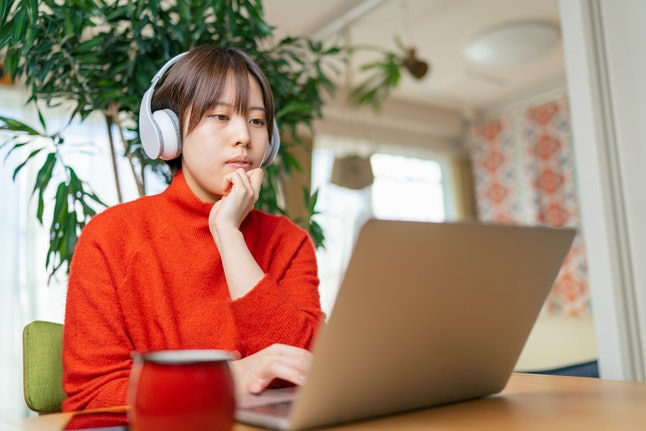 A woman does work on her laptop from home. If you need to calm down quickly, giving yourself some structure can help.