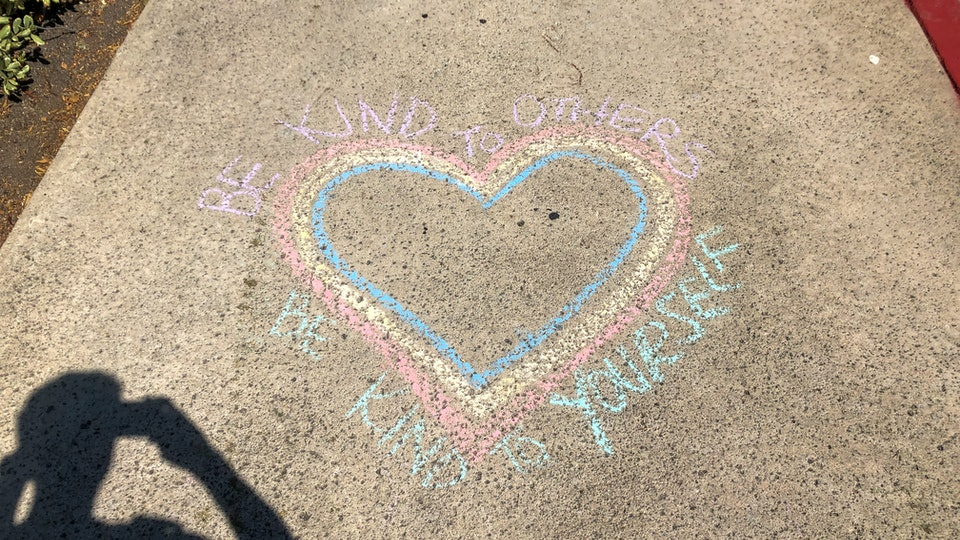 People are writing on their sidewalks in an effort to communicate messages of hope.