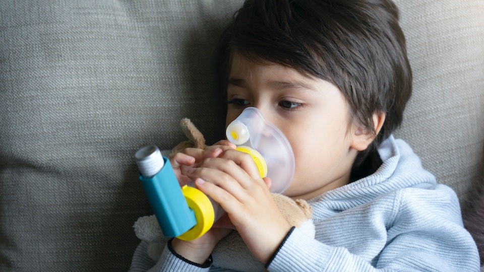 Is Coronavirus More Dangerous In Kids With Asthma? Kid using inhaler