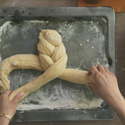 A woman braids challah. Bread-baking is one social-distancing project often found on Instagram