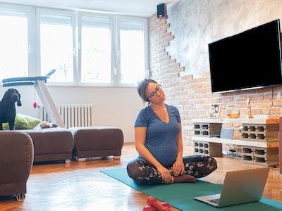 pregnant woman doing prenatal yoga