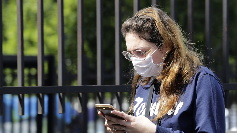 A woman wears a facemask. The spread of coronavirus may be concerning, but it's important to know the symptoms and take correct steps if you think you're infected, experts say.