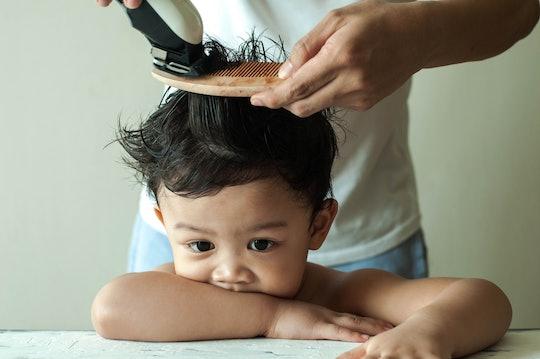 little boy getting his hair cut