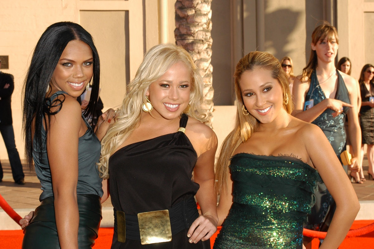 The Cheetah Girls attend a red carpet event.