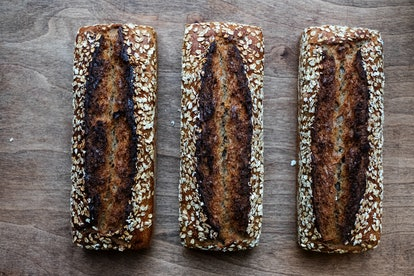 Three sourdough breads with oats on top. Sourdough bread and white bread have the same health benefits, which is to say minimal.