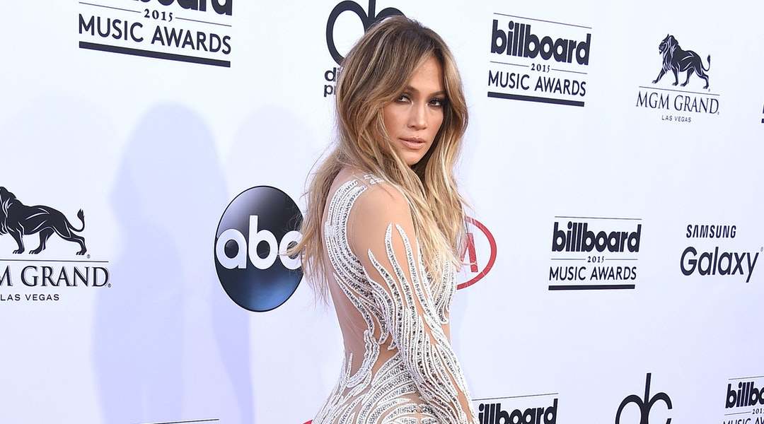 J.Lo's best haircuts of all time include a long cut with curtain bangs