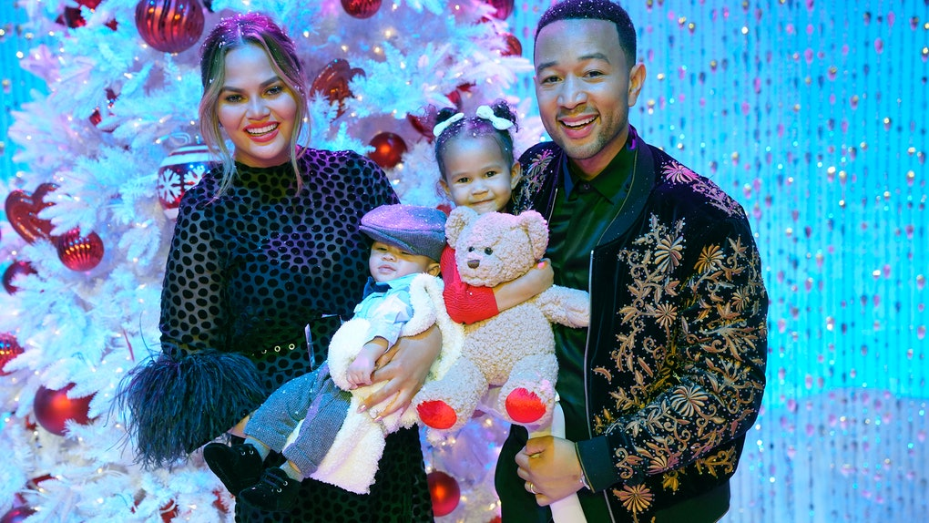 Chrissy Teigen and John Legend pose with their two kids, Luna and Miles.