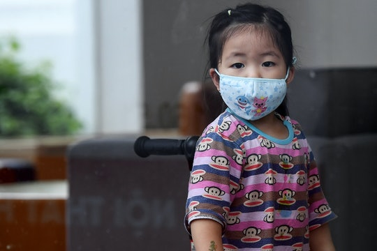 a little girl with a face mask to protect against coronavirus