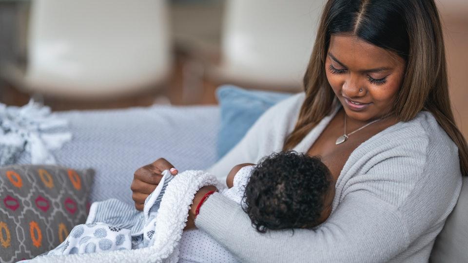 mom breastfeeding infant