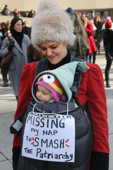 A woman and her baby braved the cold in Toronto, Canada to smash the patriarchy.