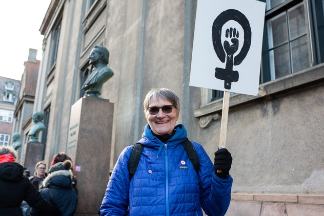 woman with feminist sign