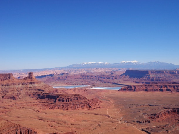 Canyonlands National Park is filled with red rock and distant mountain views.