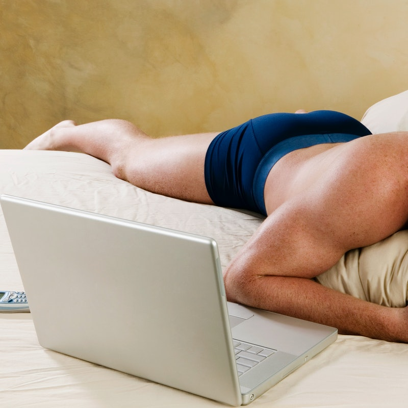 A man lies in his underwear watching porn on a laptop. What does anal sex feel like for men? We asked 12 men for their thoughts on anal sex.