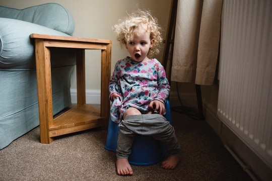 little girl sitting on potty chair