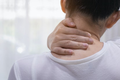 A person tries to rub out some pain in their neck. Your upper body and hips can get especially sore when you're not able to move as much as you usually do.