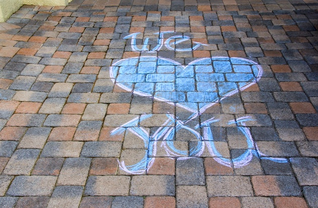 Creating inspirational messages is one activity to do with sidewalk chalk.