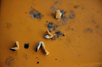 Cigarette butts on the ground. Smoking may affect your cycle, experts say.