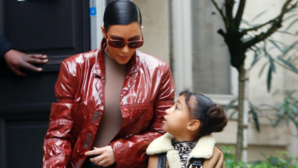 Kim Kardashian and North West take a walk.