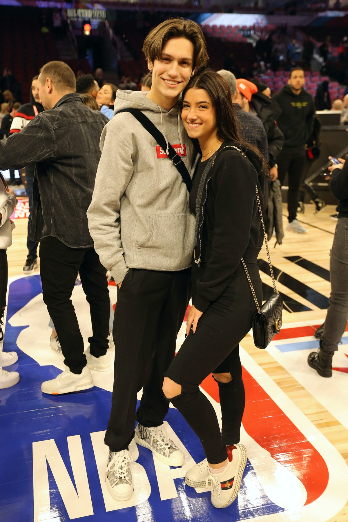 Chase Hudson and Charli C'Amelio attend an NBA game.