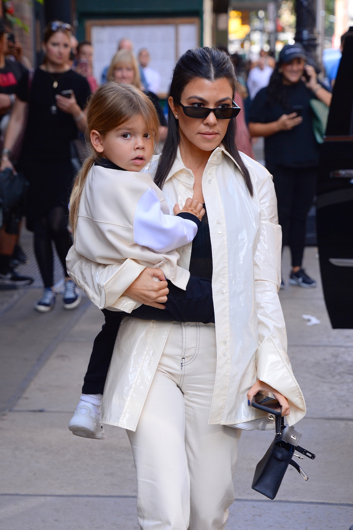 Kourtney Kardashian steps out with son Reign.