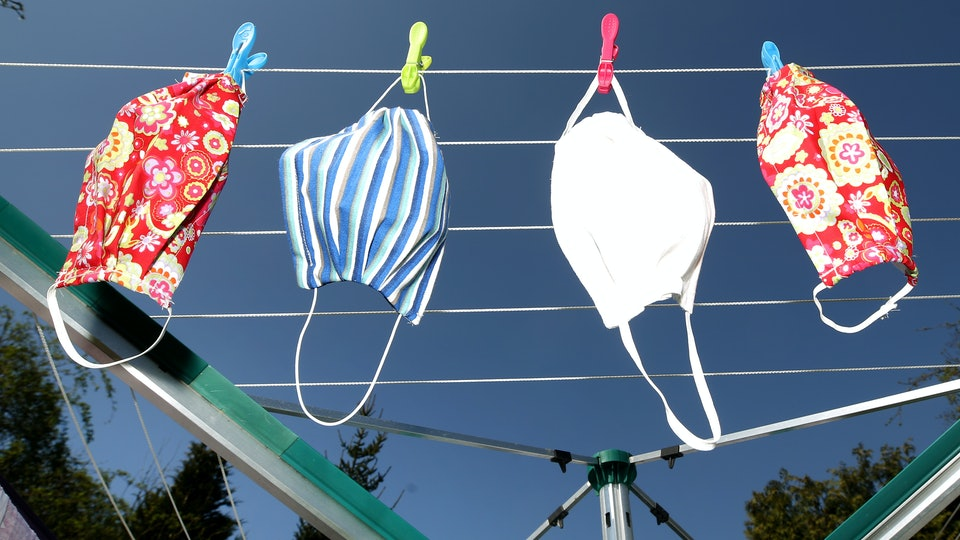 face masks on a laundry line