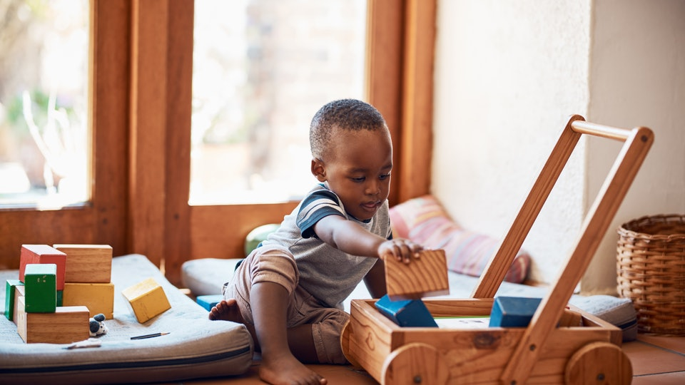 little boy playing with educational toys