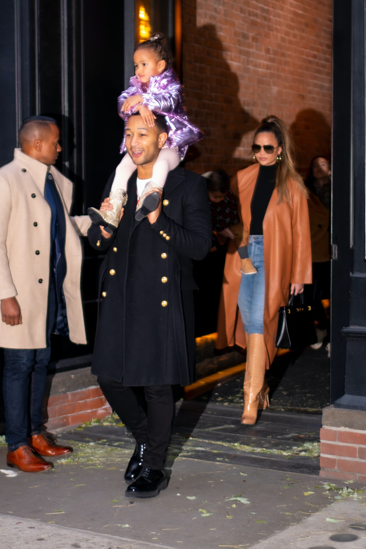 Chrissy Teigen and John Legend step out with their daughter, Luna.