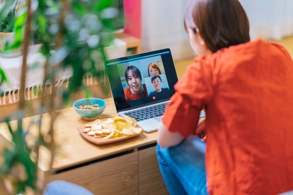 A woman does a Zoom call with her friends. Spending screen time with others can help during quarantine, but can also hurt eyes.