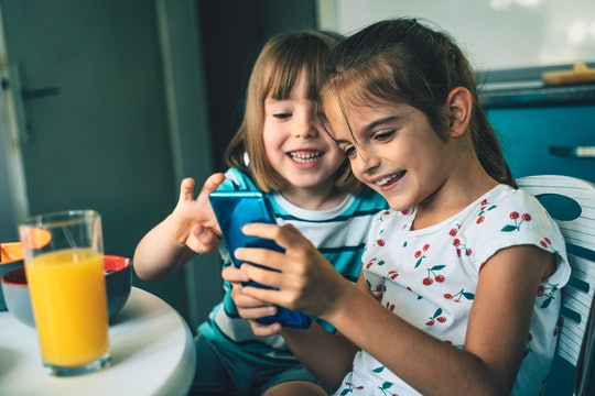 girls playing with a phone, apps