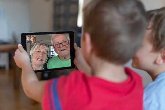 two little boys video chatting with grandparents