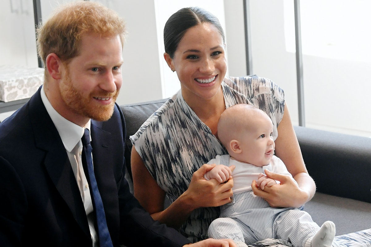 Meghan Markle and Prince Harry pose with their son Archie.