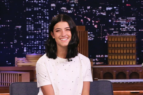 Charli D'Amelio in a white shirt and black skirt on The Tonight Show
