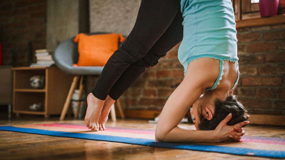A person in dolphin pose. Exercise-induced anxiety can make working out very scary, but there are ways to use exercise to reduce anxiety.