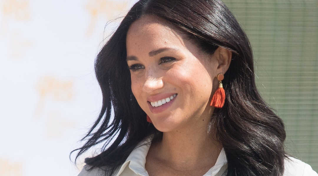 Meghan Markle's best hairstyles include bouncy waves, a tidy topknot, ponytails, and her signature low bun