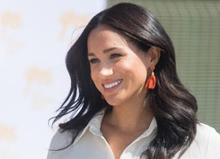 Meghan Markle's best hairstyles include bouncy waves, a tidy topknot, ponytails, and her signature l...