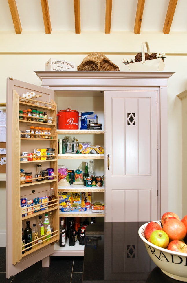 Your pantry door can be transformed into kitchen organizational shelving.