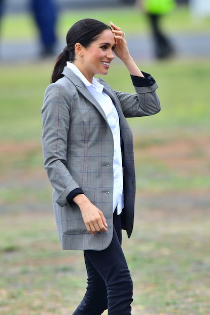 Meghan Markle's best hairstyles include a casual low ponytail