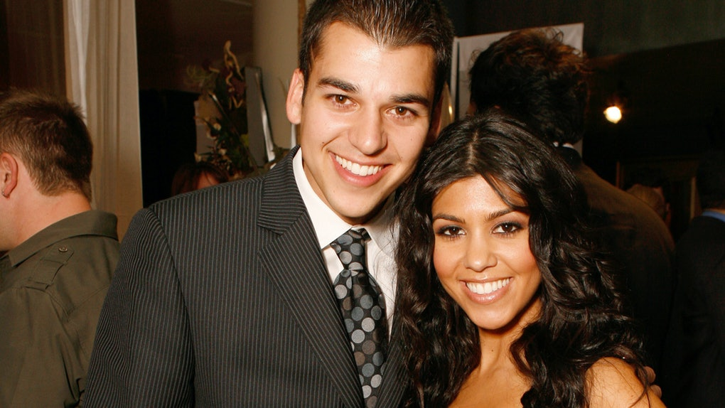 Rob Kardashian and Kourtney Kardashian pose for a photo.