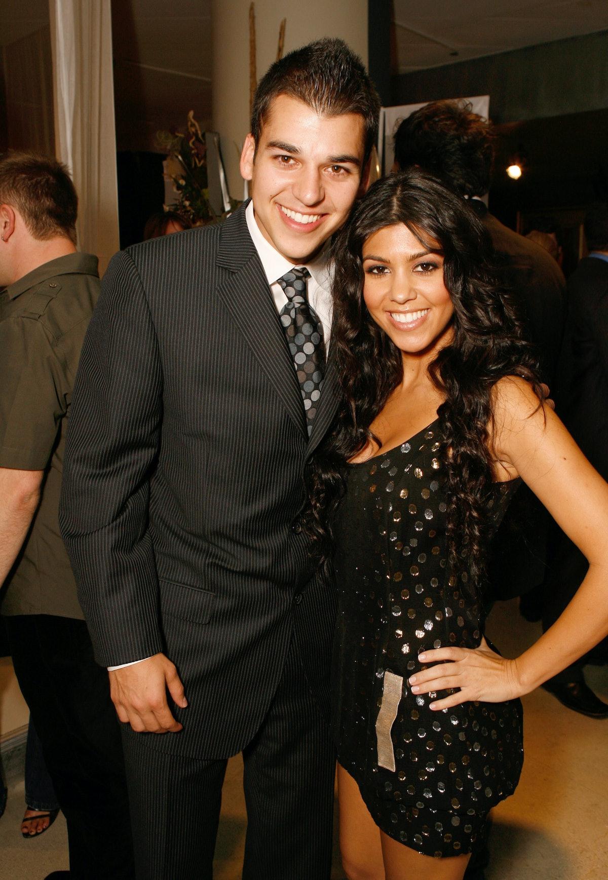Rob Kardashian and Kourtney Kardashian pose for a photo.