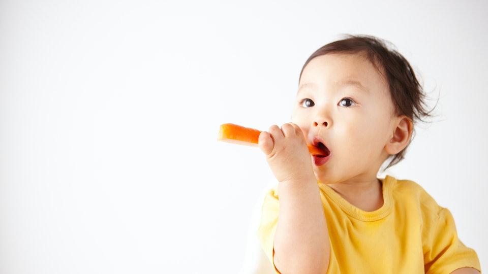 toddler girl eating
