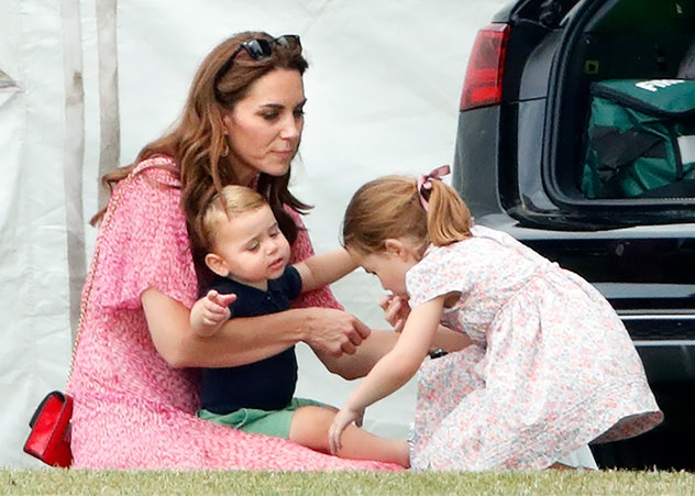 Prince Louis wants a hug from his sister.