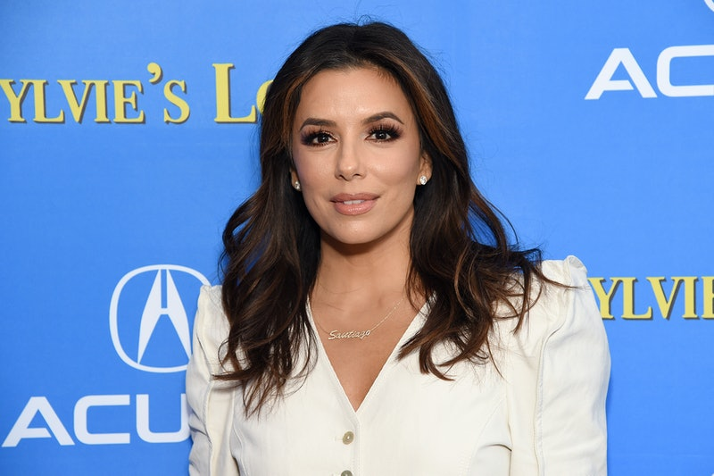 Eva Longoria uses L'Oreal Paris' Magic Root Cover Up spray on her brown hair to conceal gray roots