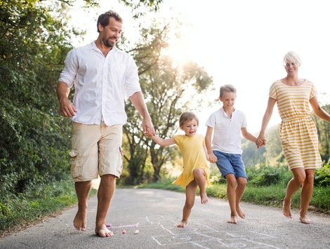 family playing hopscotch