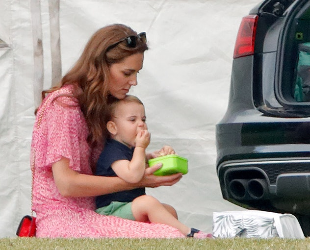 Prince Louis eating snacks.