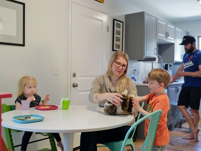 married couple with kids in kitchen during pandemic