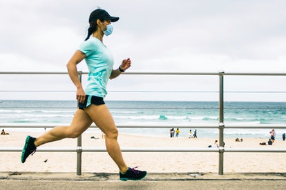 A person runs on a boardwalk while wearing a mask. Exercising outside during the pandemic can be int...