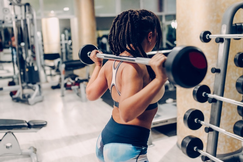 A person lifts weights in an empty gym. Gyms are reopening in Georgia, but does that mean it's safe to go back to your group fitness class?